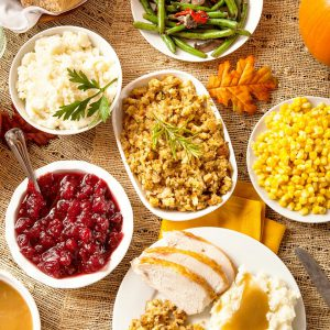 Cranberry Dressing, Cornbread Dressing, Yukon Gold Mashed Potatoes, Baked Sweet Potatoes with Toasted Pecans, Butter and Brown Sugar, Bacon Braised Green Beans, Creamed Corn